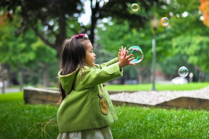 Picture of girl catching a bubble